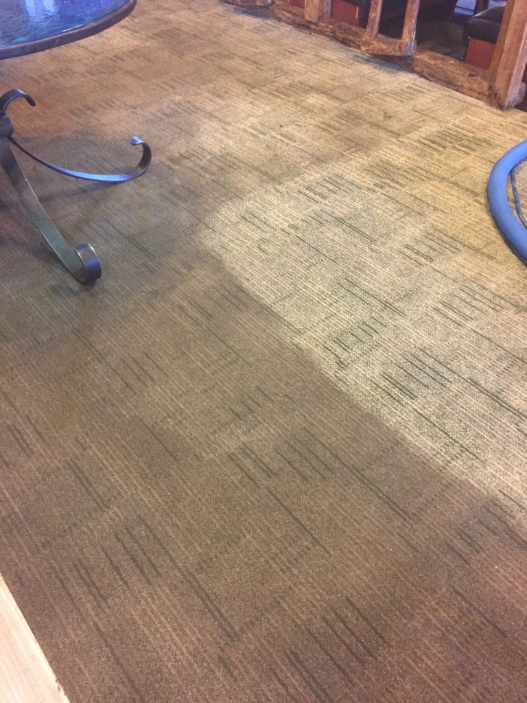 Cleaning a customer's carpets